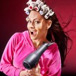 Woman wear hair curlers on head. - Stock Photo