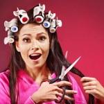 Woman wear hair curlers on head. — Stock Photo #13336648