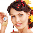 Royalty-Free Stock Photo: Woman with autumn hairstyle holding pocket watch