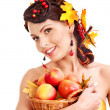 Girl  holding basket with fruit. — Stock Photo