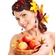 Girl holding basket with fruit. — Stock Photo #13336690
