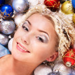 Stock Photo: Young woman in christmas balls.