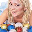 Young woman in christmas balls. — Stock Photo