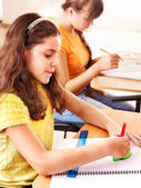 School child sitting in classroom. — Stock Photo
