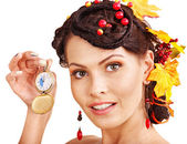 Woman with autumn hairstyle holding pocket watch — Stock Photo