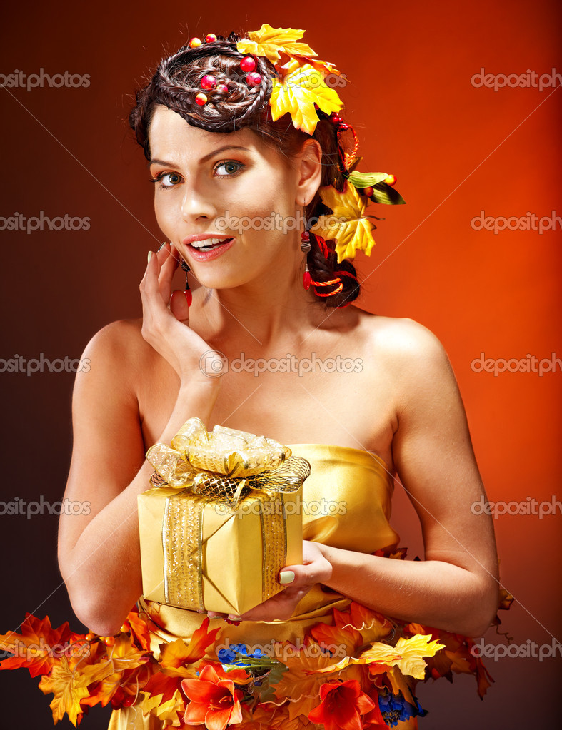 Woman with  autumn hairstyle  holding gift box.  Stock Photo #13336655
