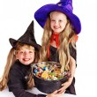 Witch  children with trick or treat. - Stock Photo