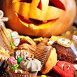 Halloween table with trick or treat — Stock Photo #13463517
