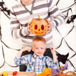 Family with child holding make carved pumpkin. — Stock Photo #13463663