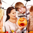 Family on Halloween party with children. — Stock Photo