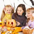 Halloween party with children holding trick or treat. — Stock Photo #13463677