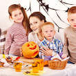 Family with child holding make carved pumpkin. — Stock Photo #13463679