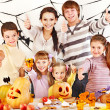 Family with child holding make carved pumpkin — Stock Photo