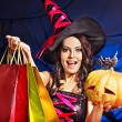 Woman holding Halloween shopping bag. — Stock Photo