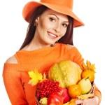 Woman holding autumn basket. — Stock Photo #13464221