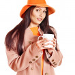 Woman wearing overcoat and hat. — Stock Photo #13464271