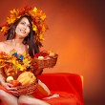Girl holding basket with fruit. — Stock Photo #13464293