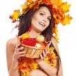 Girl holding basket with fruit. — Stock Photo #13464297