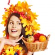 Girl holding basket with fruit. — Stock Photo #13464308