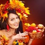 Girl holding basket with fruit. — Stock Photo #13464320