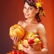 Woman holding autumn basket. — Photo