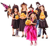Halloween party with group kid holding carving pumkin. — Stock Photo