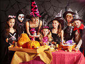 Family on Halloween party with children. — 图库照片