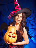 Witch holding pumkin. — Stock Photo