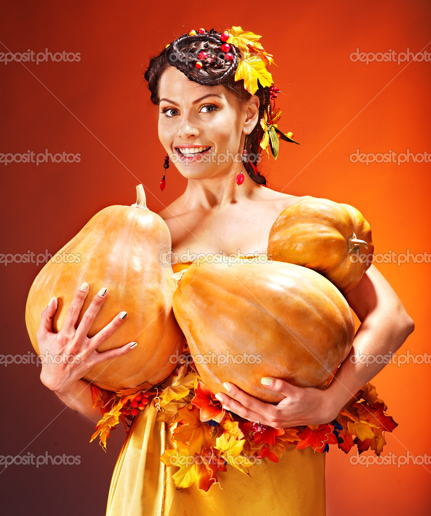 Woman holding autumn basket with fruit and vegetable.  Stock Photo #13464349