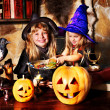 Witch children with pumpkin lantern. . — Stock Photo