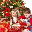 Royalty-Free Stock Photo: Children with gift box near Christmas tree.