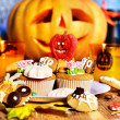Halloween table with trick or treat — Stock Photo #13614650