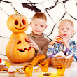 Halloween party with children holding trick or treat. — Stock Photo #13614703