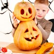 Child holding Halloween pumpkin carving . — Stock Photo #13614706