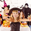 Halloween party with children holding trick or treat. — Stock Photo #13614714