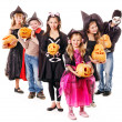Halloween party with group kid holding carving pumpkin. — Stock Photo #13614726