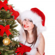 Christmas girl in santa holding gift box. - ストック写真