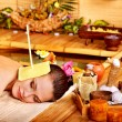 Woman getting massage with ear candle . - Foto de Stock