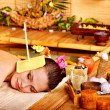 Woman getting massage with ear candle . - 图库照片