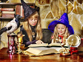 Witch children with crystal ball. — Stock Photo