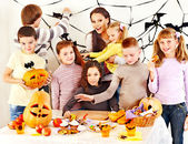 Family on Halloween party with children. — Stockfoto