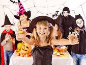 Halloween party with children holding trick or treat. — Photo