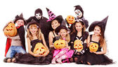 Halloween party with group kid holding carving pumpkin. — Stock Photo