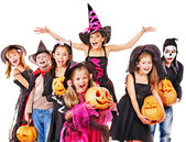 Halloween party with group kid holding carving pumpkin. — Стоковое фото