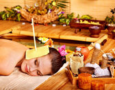 Woman getting massage with ear candle . — Foto Stock