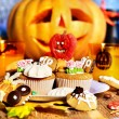 Halloween table with trick or treat — Stock Photo #13626691