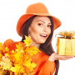 Woman holding autumn gift box . — Stock Photo #13626808