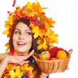 Girl holding basket with fruit. — Stock Photo #13626819