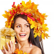 Girl with a wreath of autumn leaves on the head. — Stock Photo #13626822