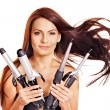 Woman holding iron curling hair. — Stock Photo #13626826